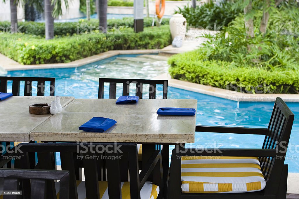 dining table at poolside royalty-free stock photo