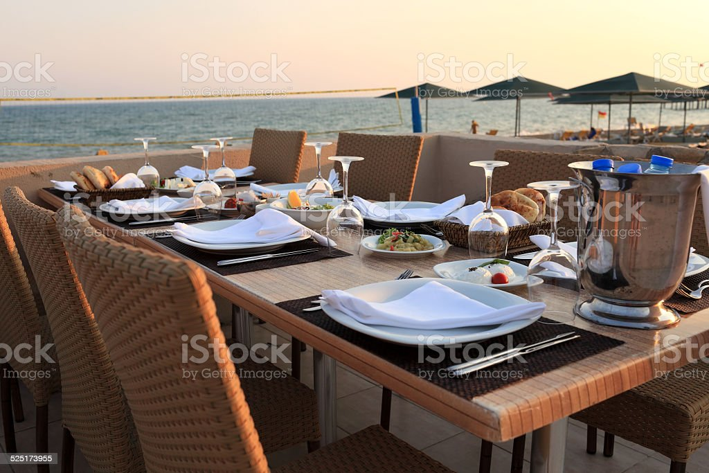 Dining table at sunset stock photo