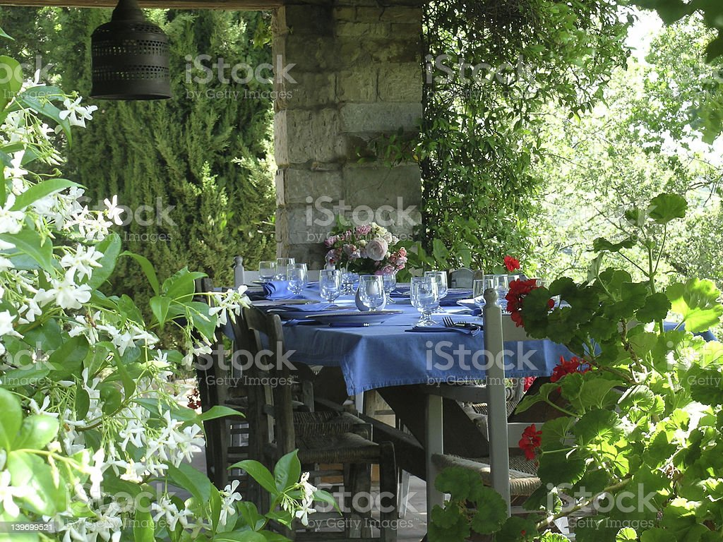 Dining table in the garden royalty-free stock photo