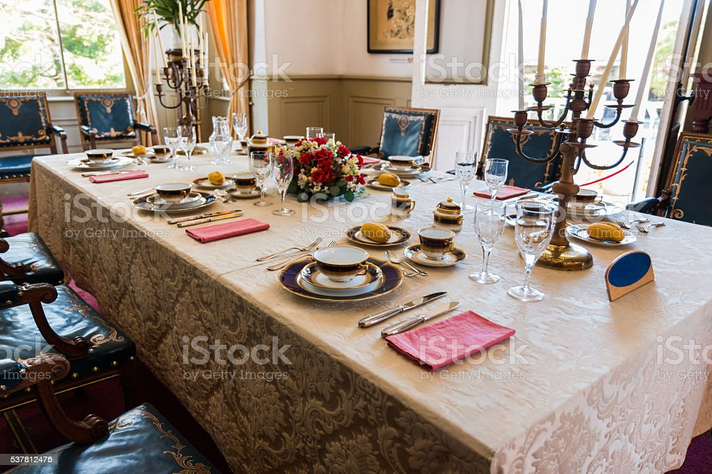 dining table in vintage style with elegant table setting. stock photo