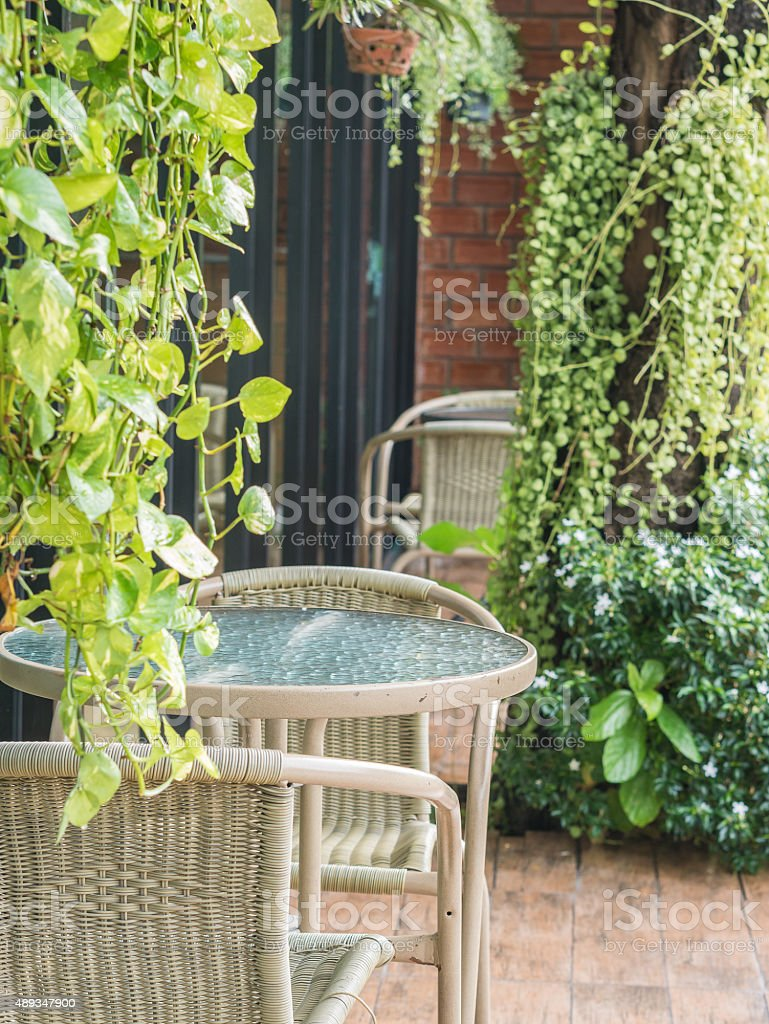 Dining table on terrace full of green trees. royalty-free stock photo