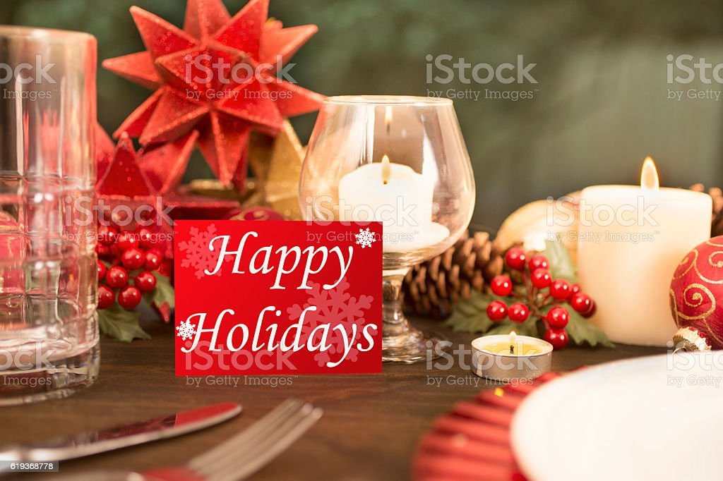 Beautiful Christmas place setting on dining table. \'Happy Holidays \'...