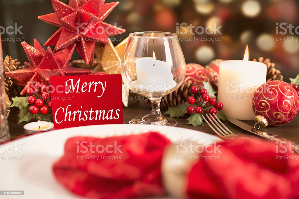 Merry Christmas Decorations dining table place setting with merry christmas decorations stock