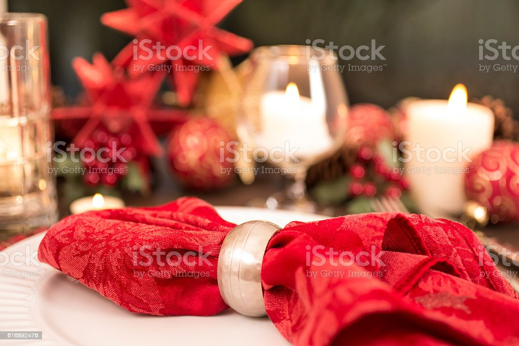 Dining table place setting with Merry Christmas holiday decorations. stock photo