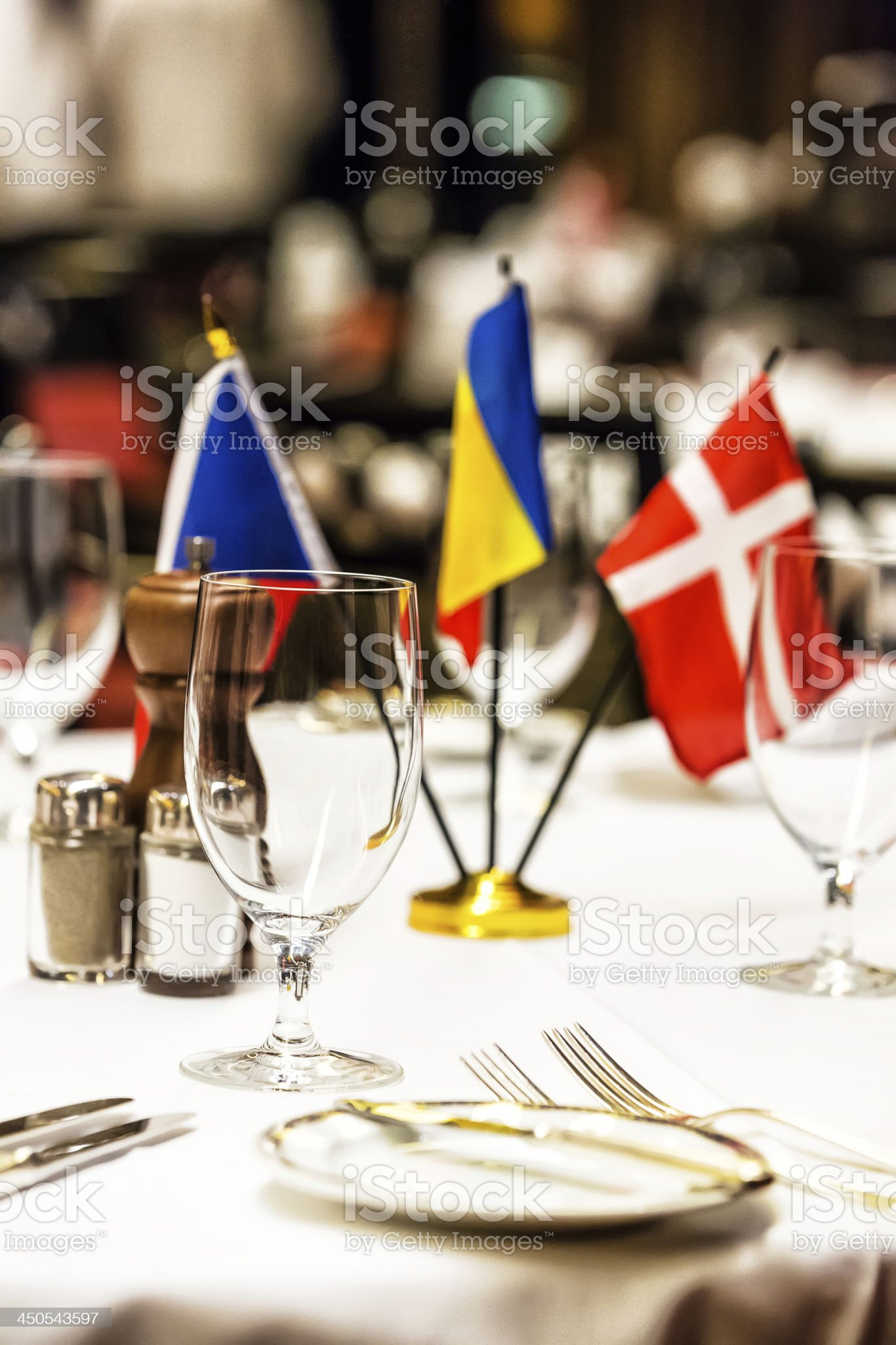 Dining table set with multi national flag centerpiece royalty-free stock photo