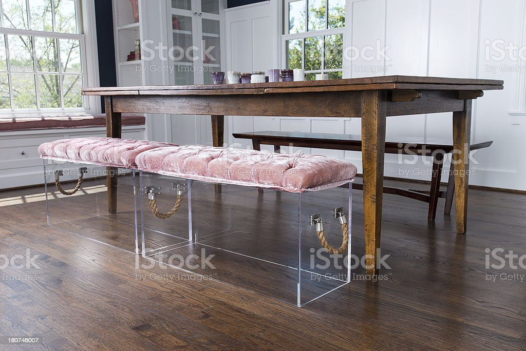 Dining Table With Acrylic Benches stock photo