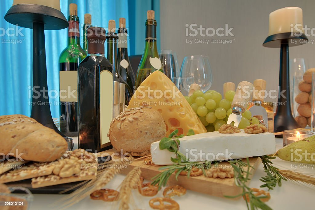 Dining table with wine and cheese stock photo