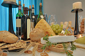 Dining table with wine and cheese