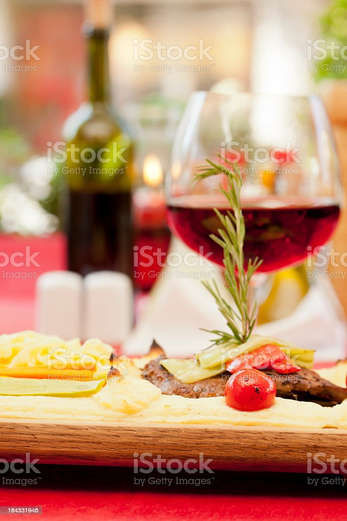 Dinner and wine: steak with tomato royalty-free stock photo