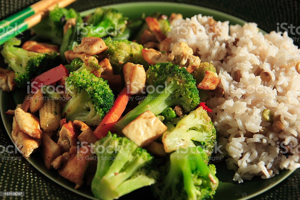 Dinner consisting of a vegetarian stir fry in a bowl royalty-free stock photo