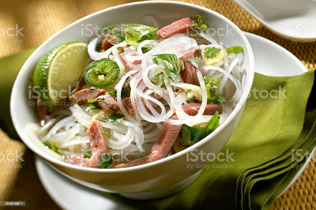 Dinner consisting of beef and Asian noodles stock photo