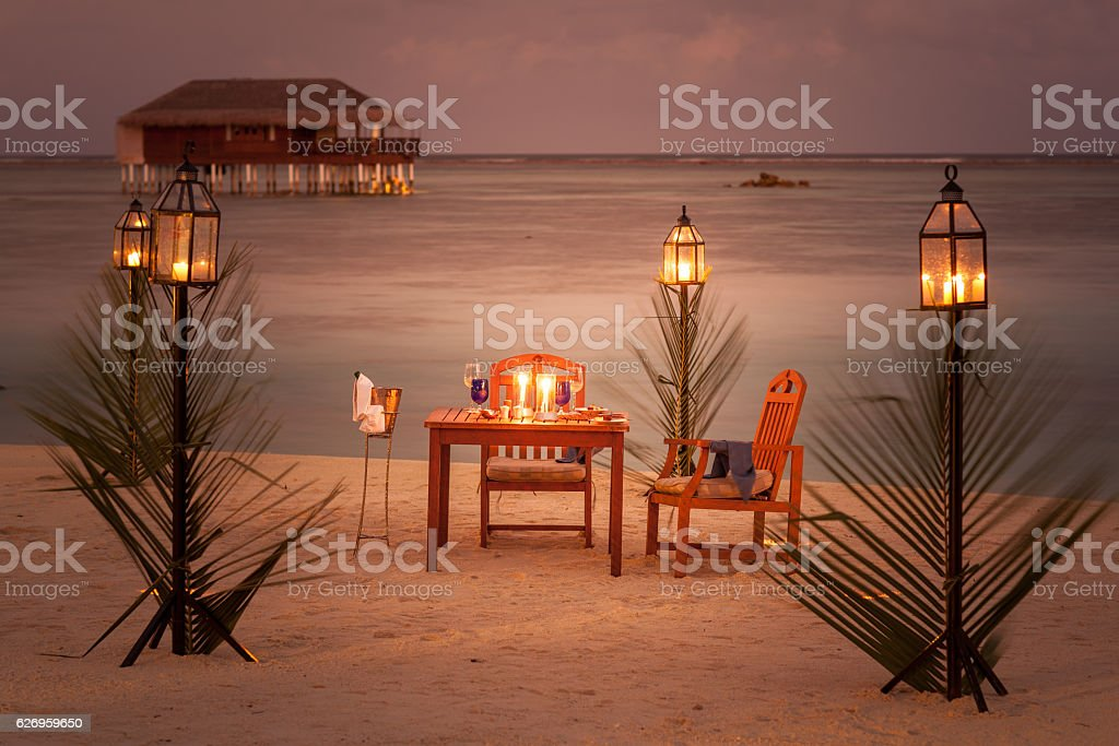 dinner for two on tropical island stock photo