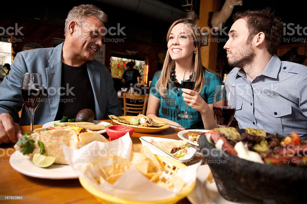Dinner Group at Nice Restaurant Eating Together stock photo