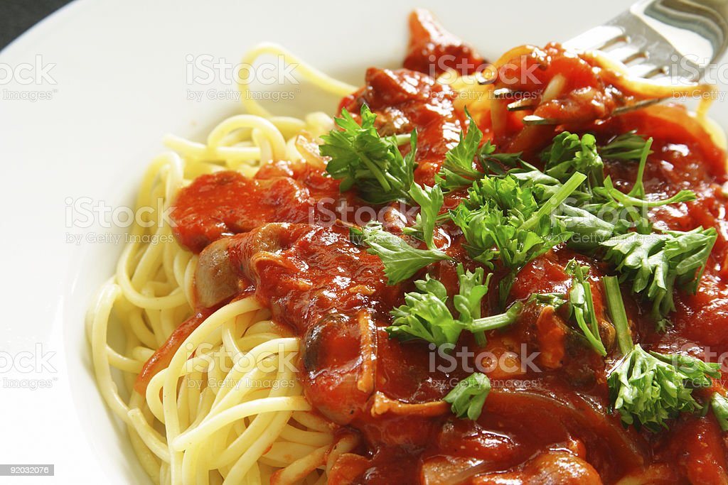 Dinner of spaghetti and tomato sauce stock photo