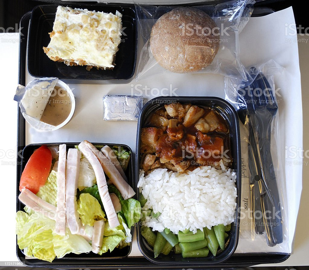 Dinner on an airplane stock photo