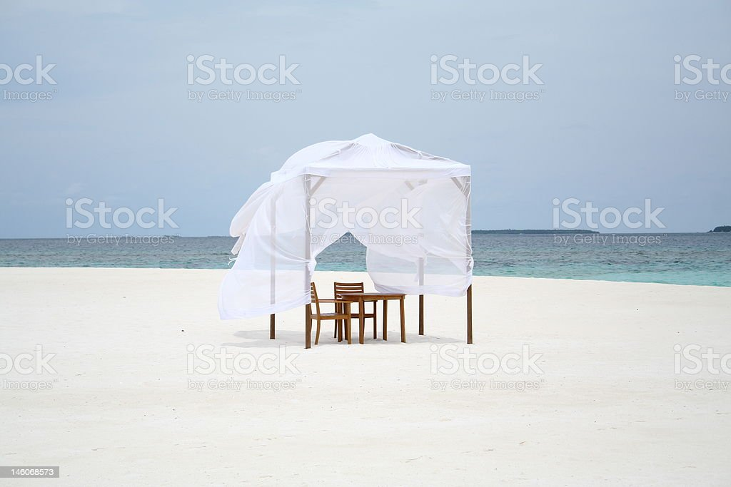 Dinner on the beach royalty-free stock photo