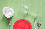 dinner place setting a red plate with silver fork