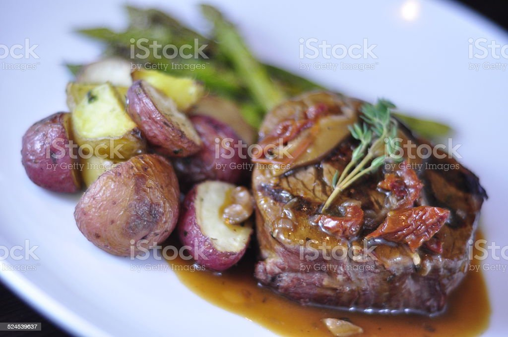 Dinner Plate of Filet Mignon, Asparagus and Baby Potatoes stock photo