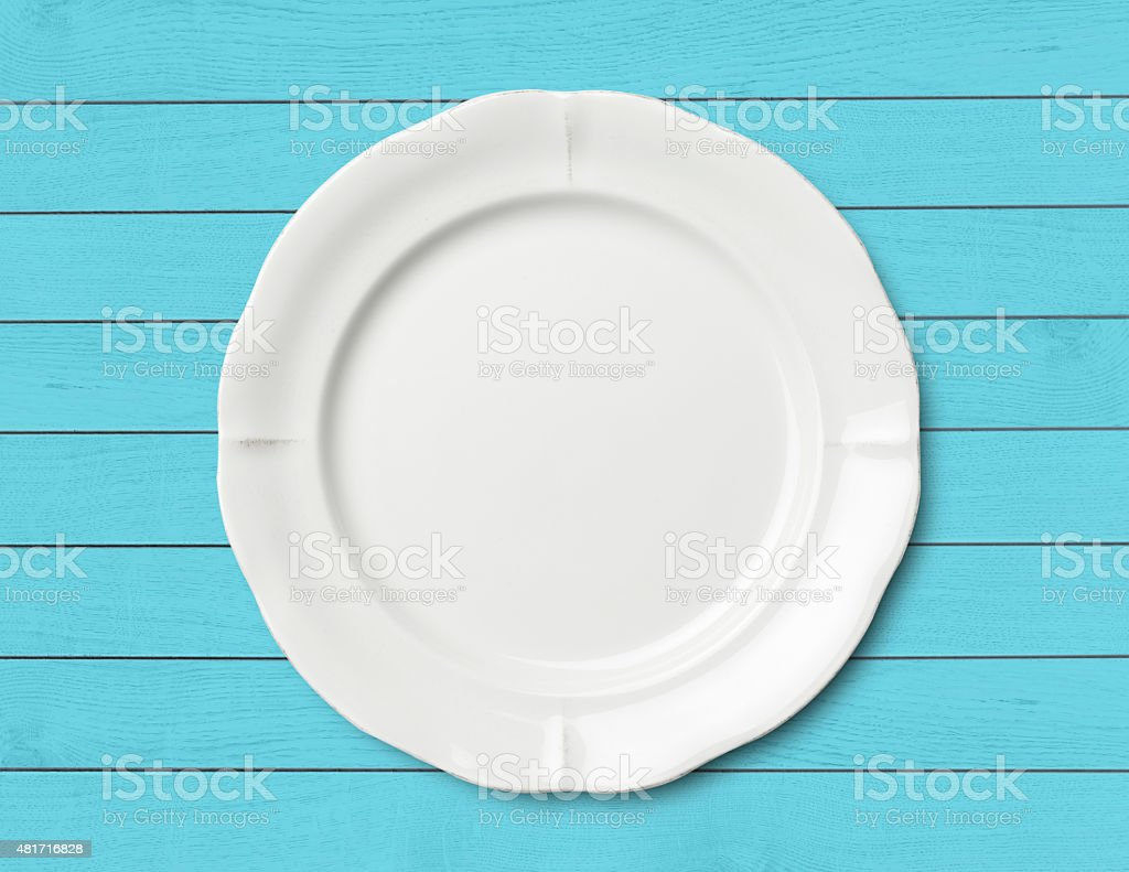Dinner plate on wood table stock photo