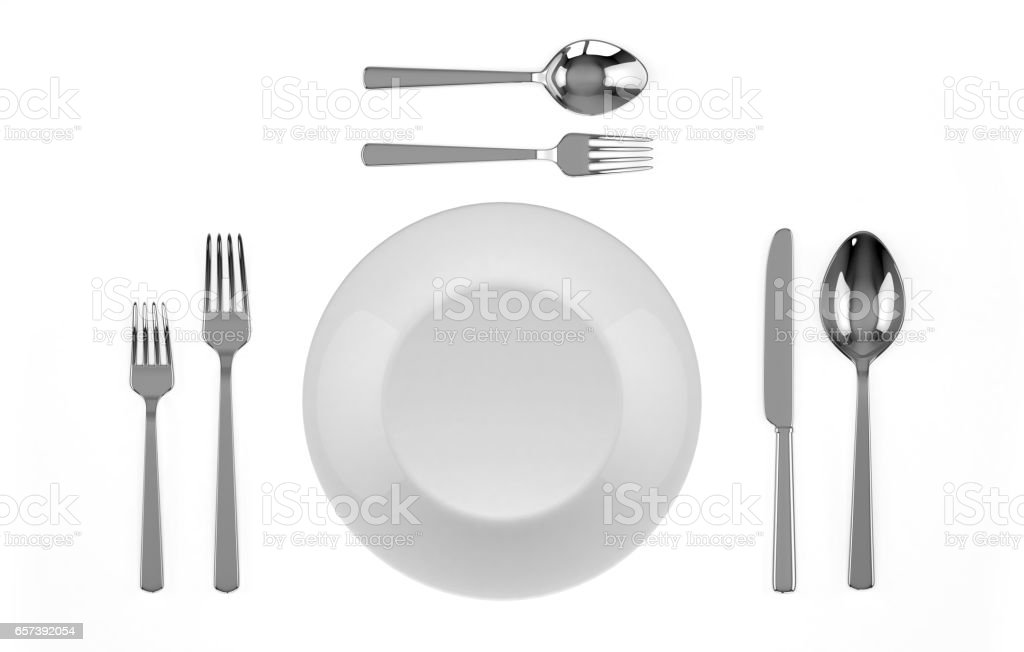 Dinner plate setting top view.Plate with spoon, knife and fork. stock photo