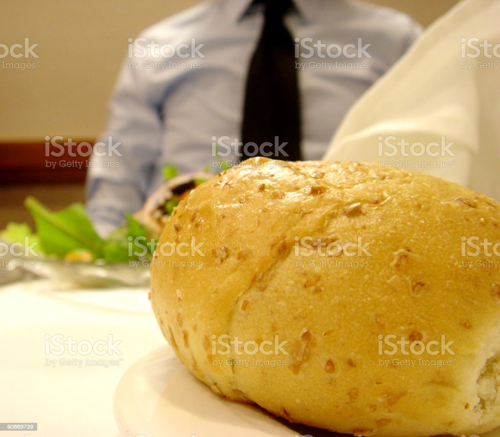 Dinner Roll with Business Man Eating Salad royalty-free stock photo