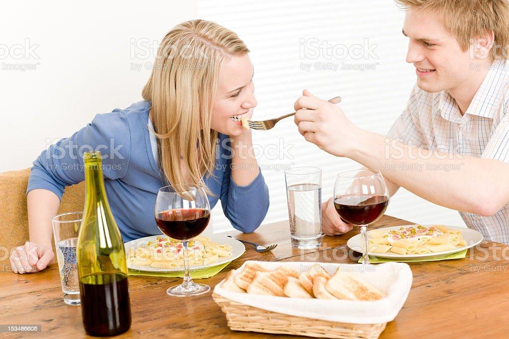 Dinner romantic couple enjoy wine eat pasta royalty-free stock photo
