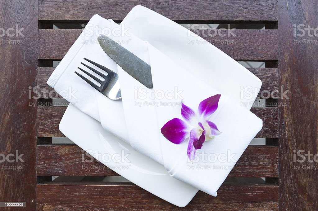 Dinner setting on wooden table royalty-free stock photo