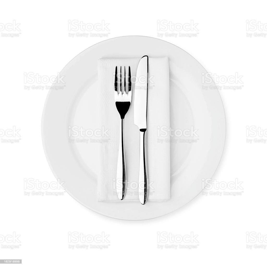 Dinner Setting - White Plate, Knife, Fork and Serviette stock photo