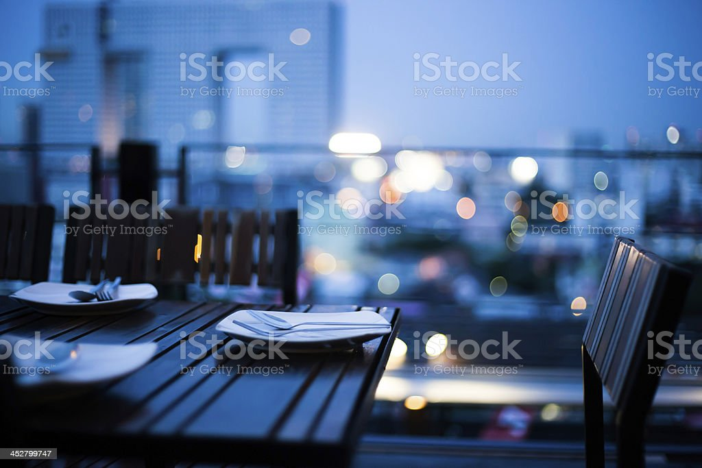 dinner setting with night and light of skyscraper view ,bangkok, stock photo