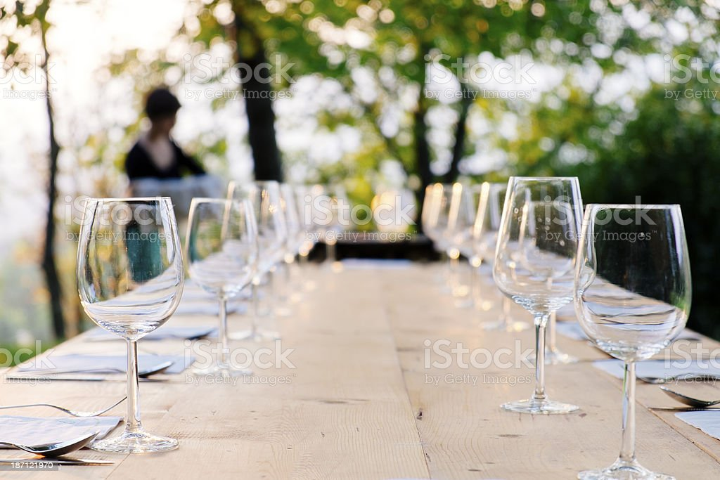 Dinner table served with wine glasses and cutlery stock photo