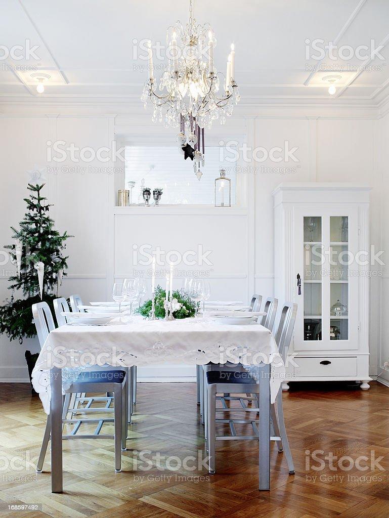Dinner table set for a minimalistic Christmas celebration stock photo