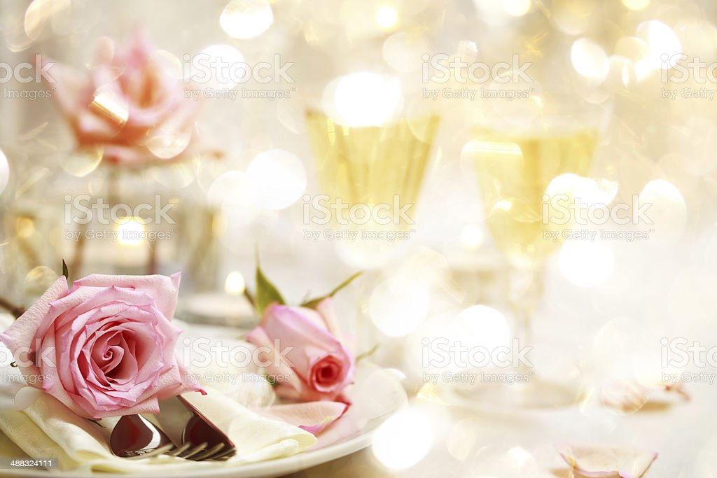 Dinner table with beautiful pink roses stock photo