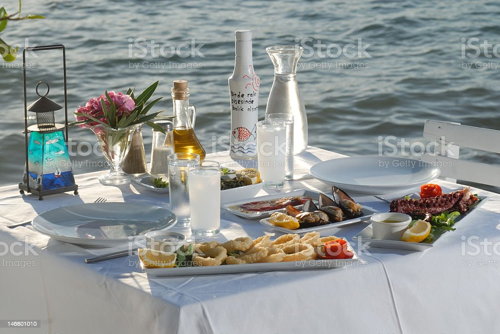 A dinner table with seafood by the ocean  stock photo