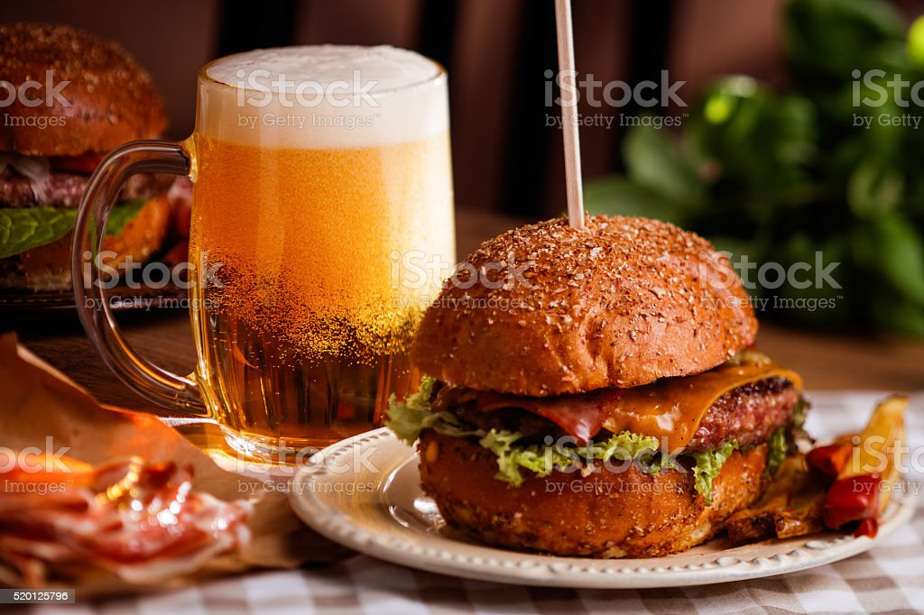 dinner with burger and beer stock photo
