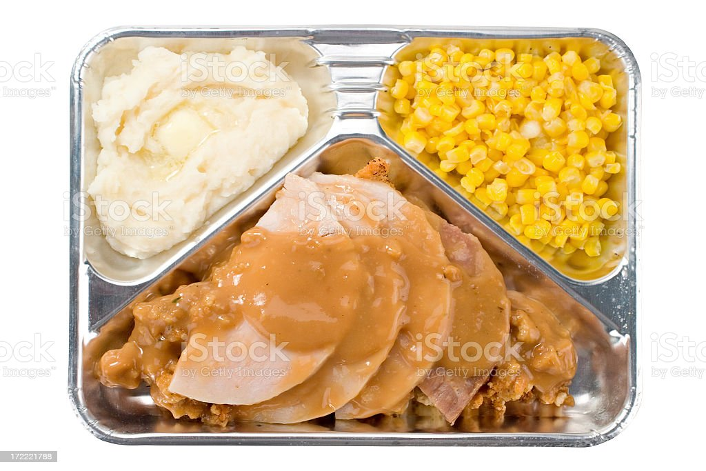 TV dinner with turkey and gravy, mashed potatoes, and corn stock photo