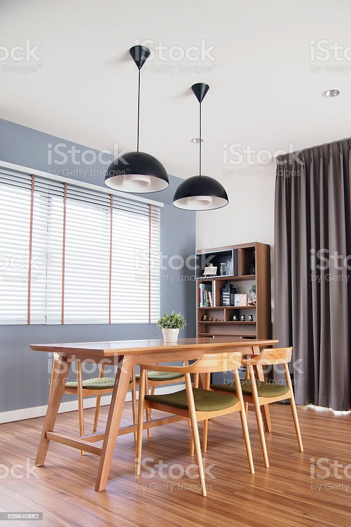 dinning table set in cozy dining room with blinds window stock photo