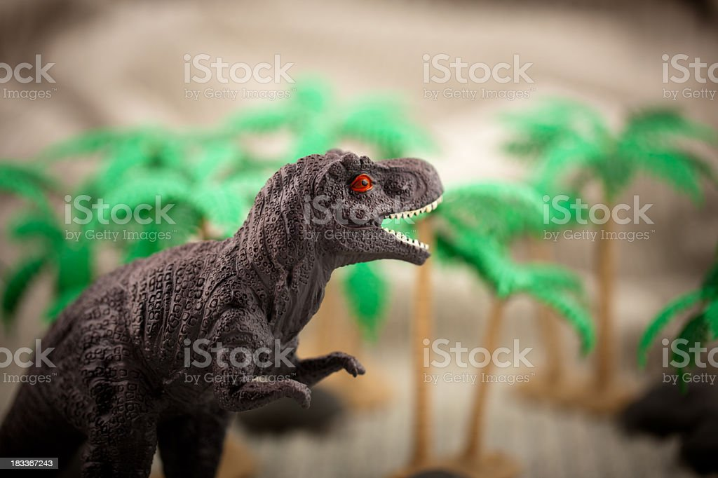 Dinosaur emerging from canopy royalty-free stock photo