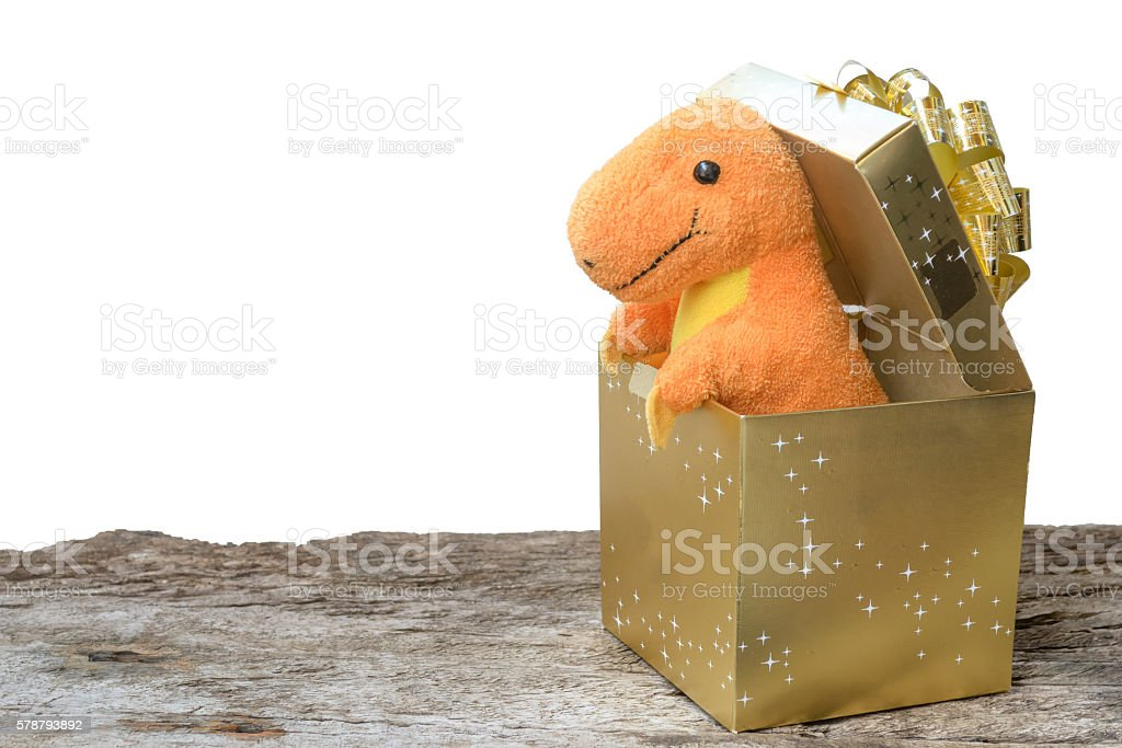 dinosaur toy in the gold box stock photo