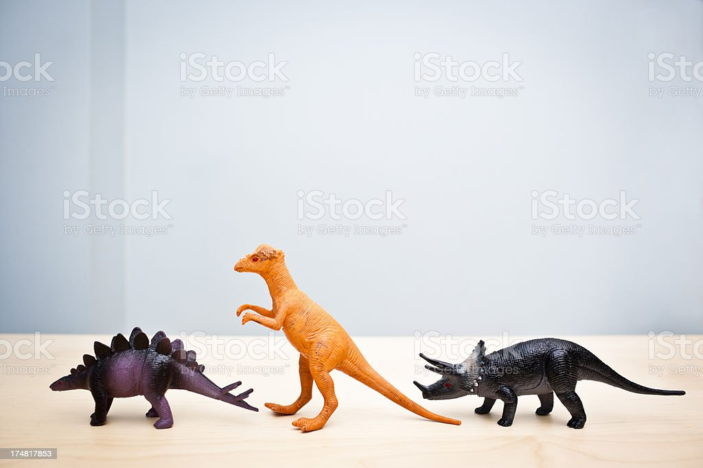 Dinosaurs in a row royalty-free stock photo