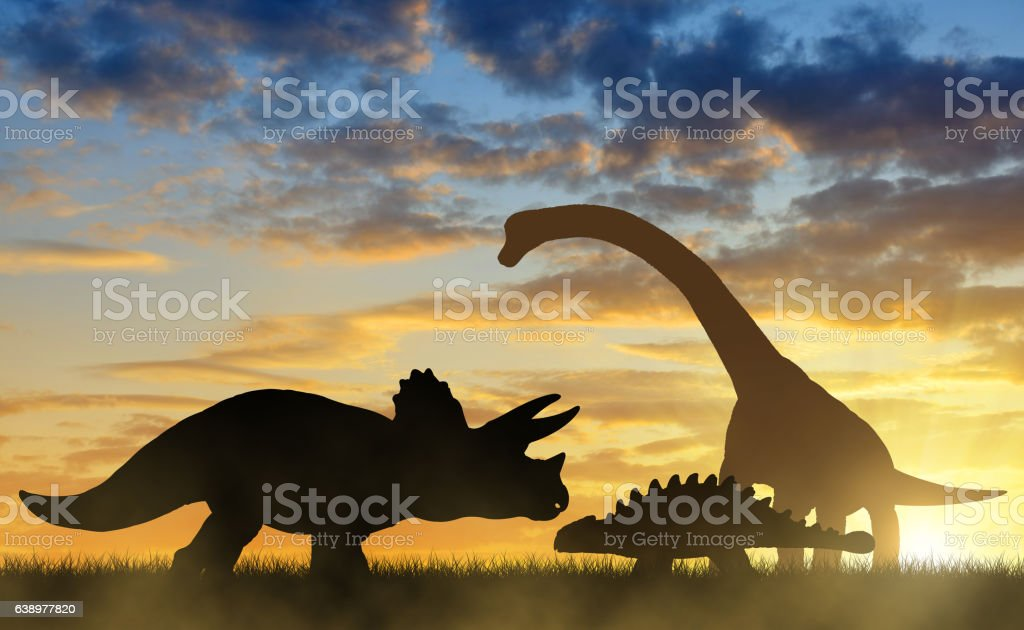 Dinosaurs in the sunset stock photo