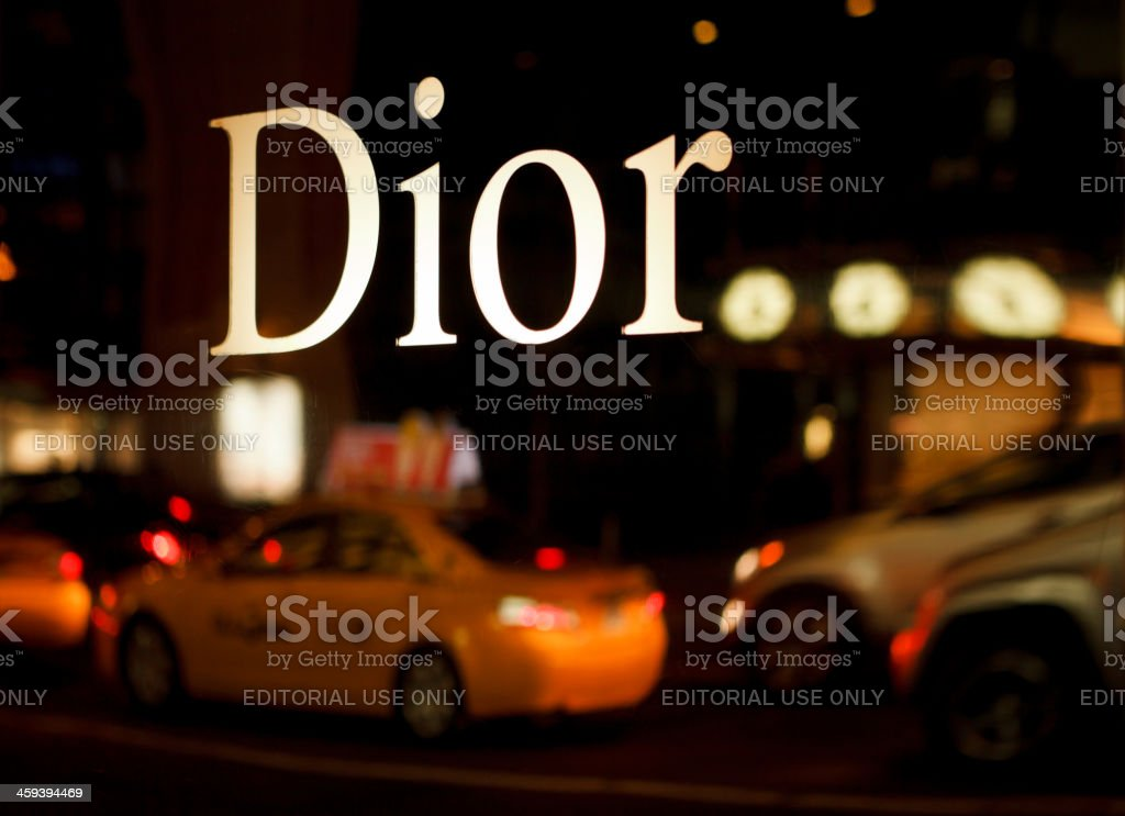 Dior Sign Reflects Traffic 57th Street Manhattan stock photo
