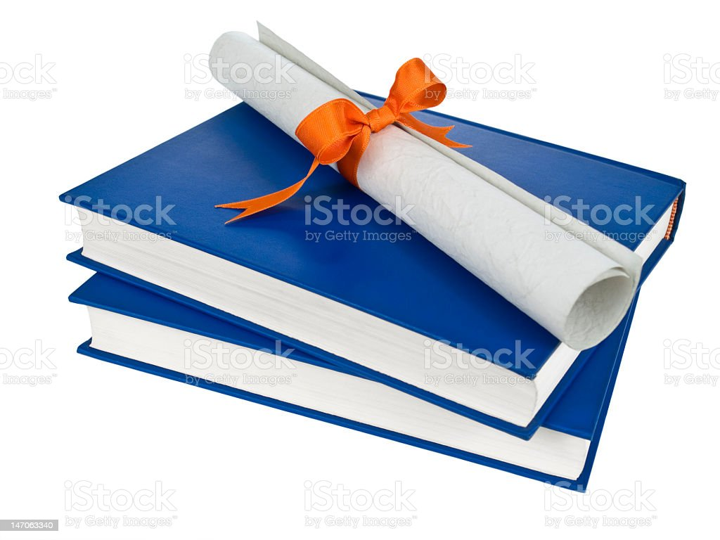 Diploma on top of two blue hardcover books royalty-free stock photo