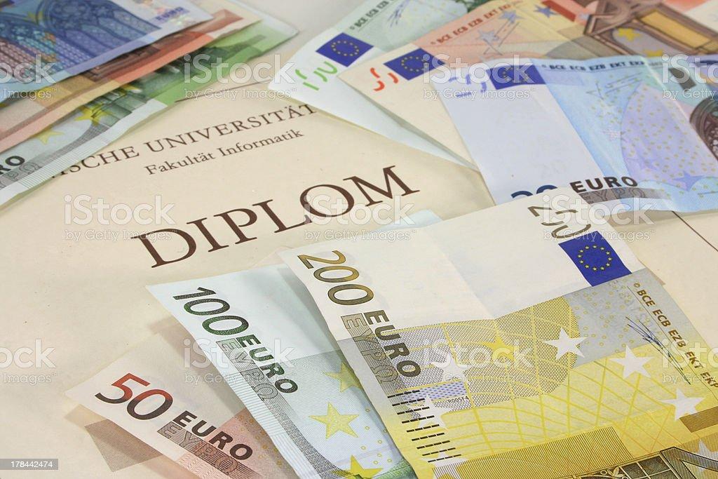 diploma with euro notes royalty-free stock photo