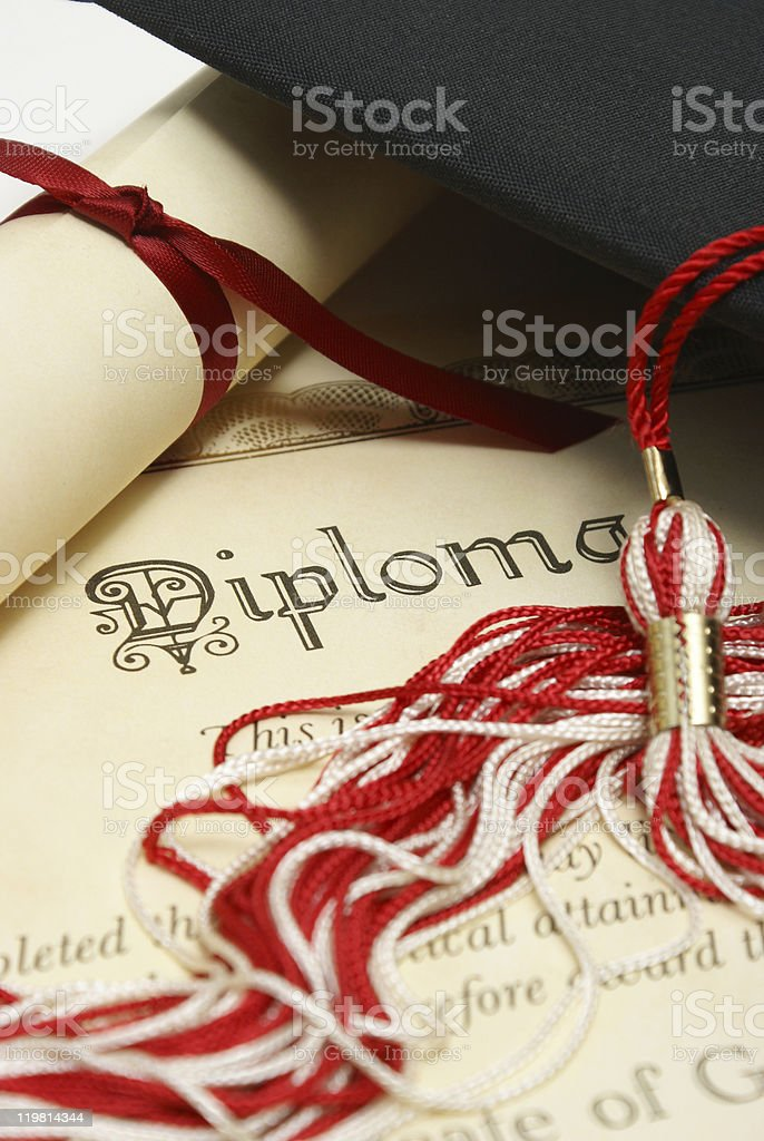 Diploma with graduation cap and tassel stock photo