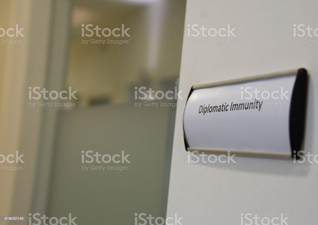 Diplomatic immunity sign stock photo