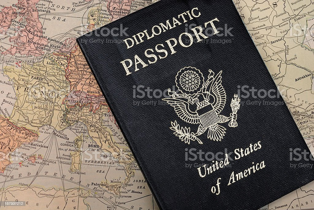 Diplomatic Passport on map of Europe stock photo