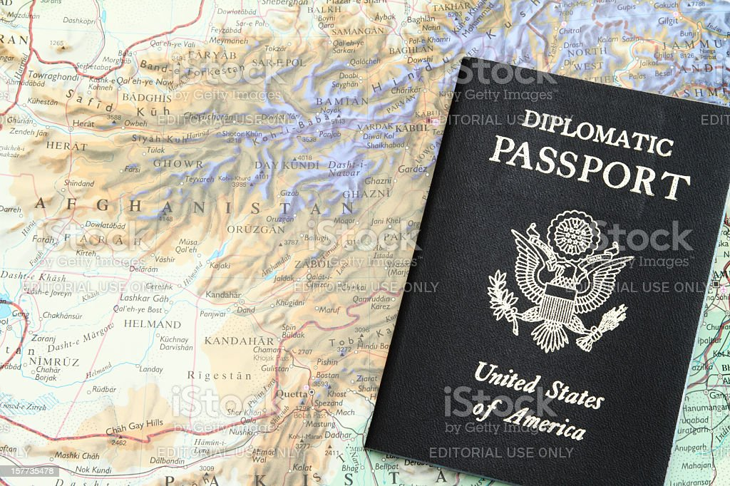 Diplomatic passport on map of the Afghanistan stock photo