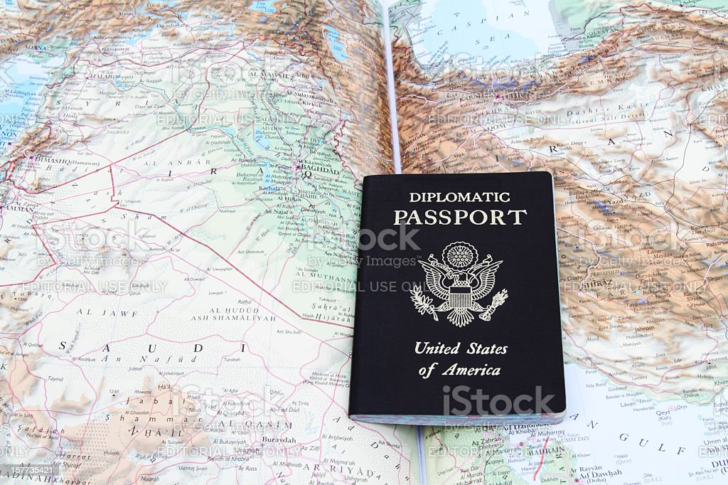 Diplomatic passport on map of the Mideast stock photo