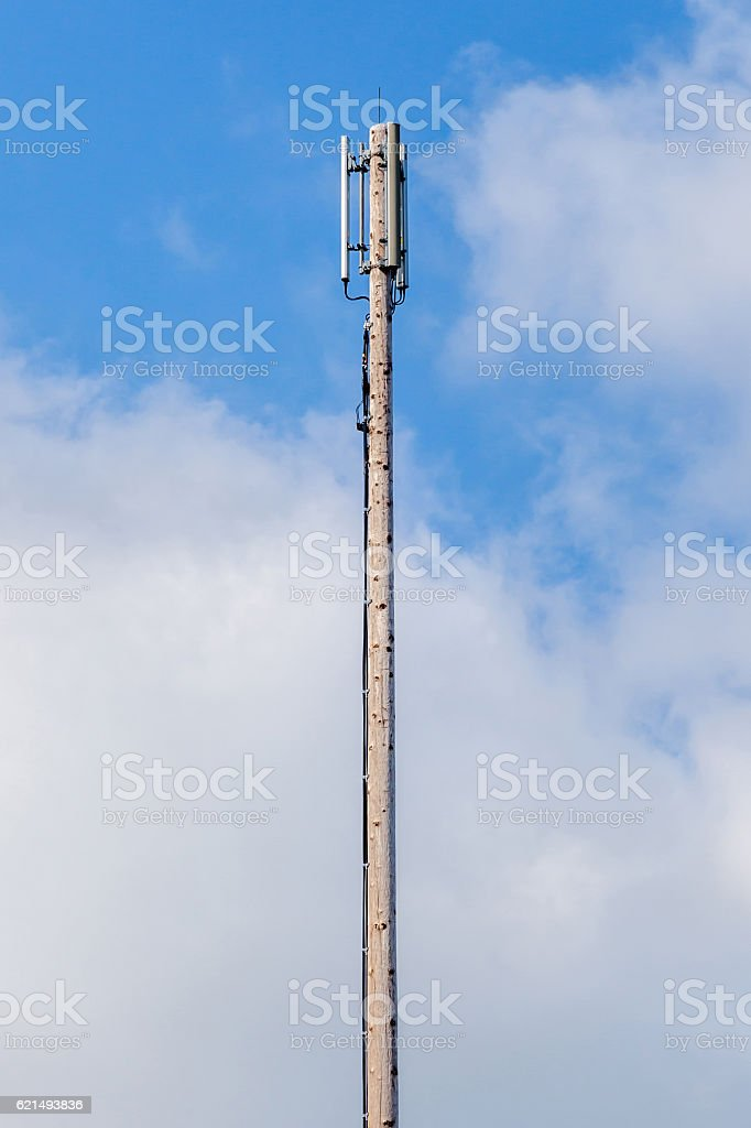 Dipole antenna for telecommunications with blue sky background. stock photo