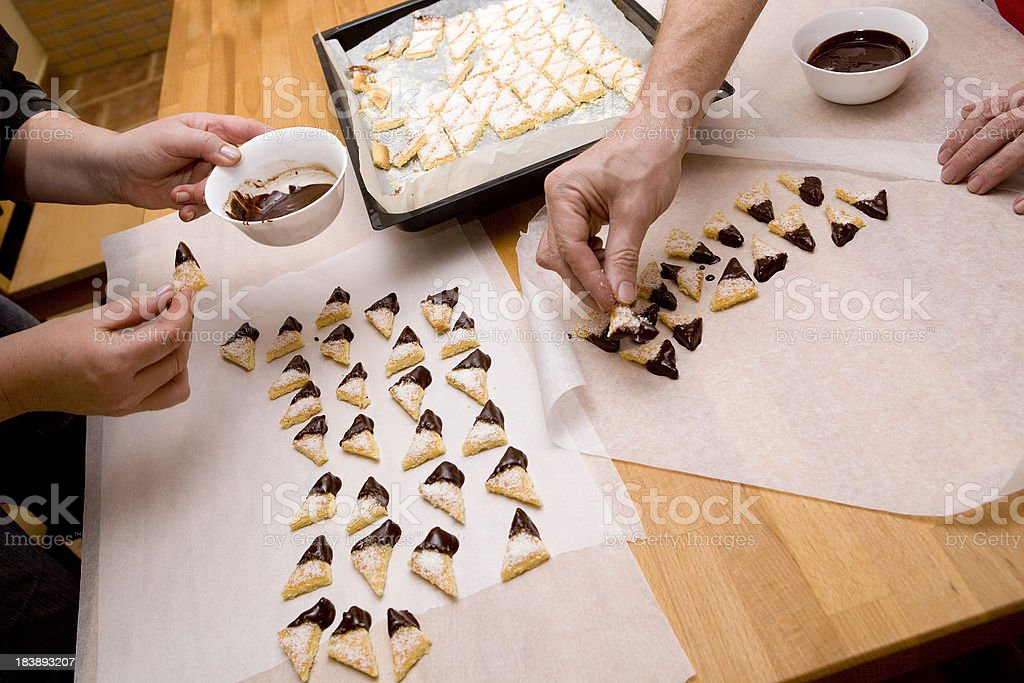 Dipping cookies in chocolate stock photo